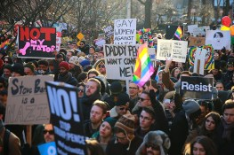 People hold signs and flags at a rally in front of the Stonewall Inn in solidarity with immigrants, asylum seekers, refugees, and the LGBT community, Feb. 4, 2017 in New York. (Photo: Gordon Donovan/Yahoo News)