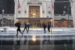 The reflections of people off the wet sidewalk as they pass the MetLife Building in New York City during a winter storm on Feb. 9, 2017. (Gordon Donovan/Yahoo News)