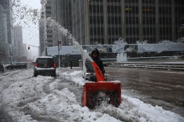 A worker plows snow outside commercial buildings on Park Avenue in New York City after a winter storm on Feb. 9, 2017. (Gordon Donovan/Yahoo News)
