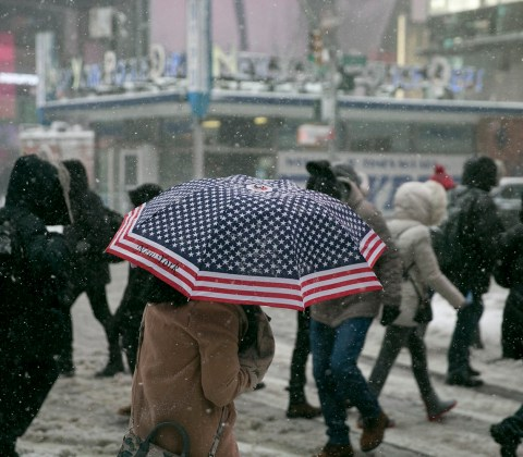 A woman carries an U.S. flag umbrella in Times Square to fight off the elements during a winter storm in New York City on Feb. 9, 2017.(Photo: Gordon Donovan/Yahoo News)