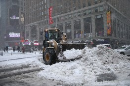 A bulldozer piles up snow in Times Square in New York City after a winter storm on Feb. 9, 2017. (Gordon Donovan/Yahoo News)