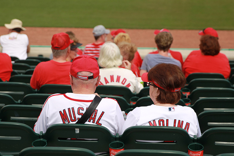 Fans wearing jerseys with late Hall of Famer Stan Musial and current Cardinal Yadier Molina sit in seats before a spring training baseball game between the New York Mets and St. Louis Cardinals at Roger Dean Stadium in Jupiter, Fl., Wednesday, March 1, 2017. (Gordon Donovan/Yahoo Sports)