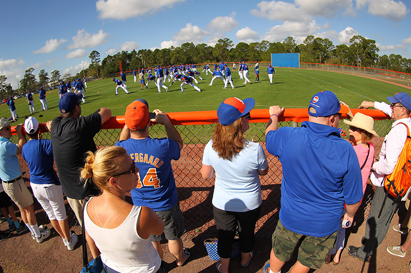 New York Mets fans line the fences to watch players loosen up before morning workouts at the New York Mets spring training facility at First Data Field in Port St. Lucie, Fl., Thursday, March 2, 2017. (Gordon Donovan/Yahoo Sports)