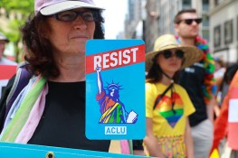 A woman holds up a resist signs before the start of the N.Y.C. Pride Parade in New York on June 25, 2017. (Photo: Gordon Donovan/Yahoo News)
