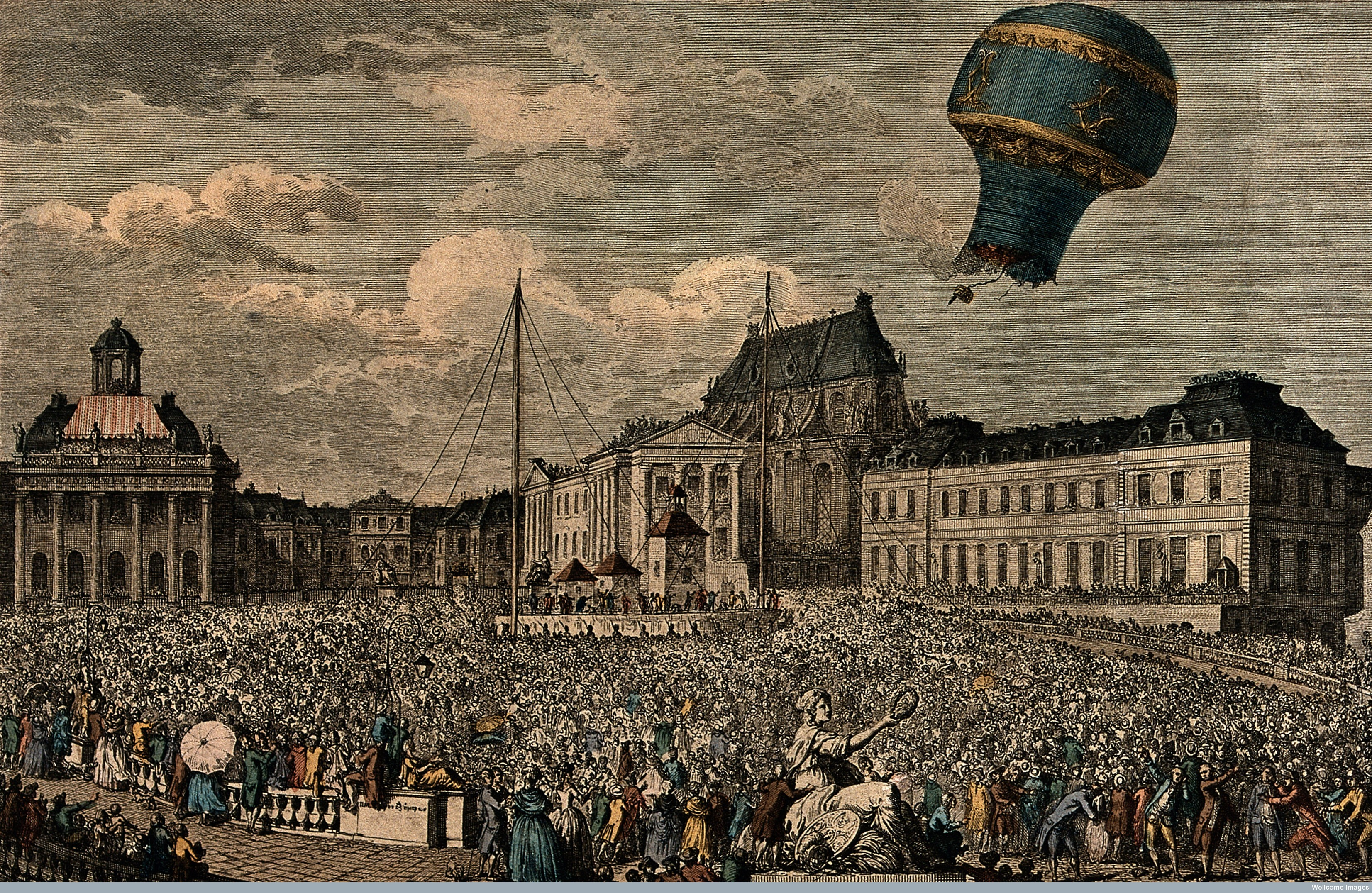 V0040878 A huge crowd watches from the streets as a hot-air balloon t