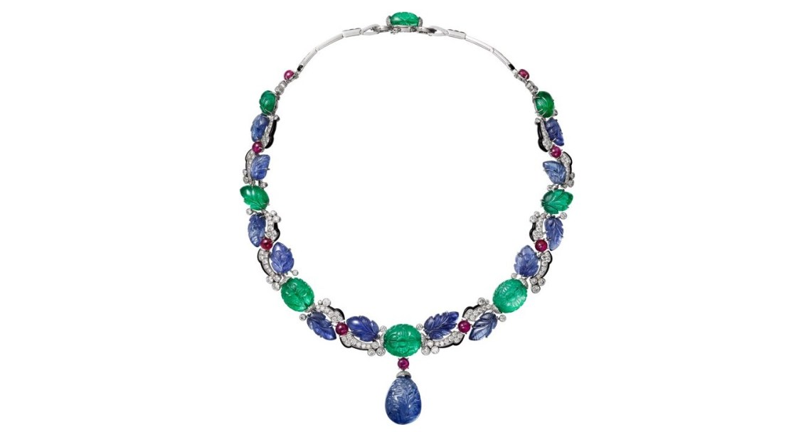 CARTIER. Necklace - platinum, one 42.77-carat carved sapphire from Ceylon, carved sapphires and emeralds, cabochon-cut rubies, calibrated sapphires, onyx, brilliant-cut diamonds. The carved sapphire drop is removable.