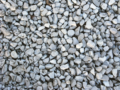 White crushed stone surface background texture