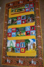 Wizard of Oz Dorothy Follow the Yellow Brick Road Timeless Treasures Poppies Emerald City