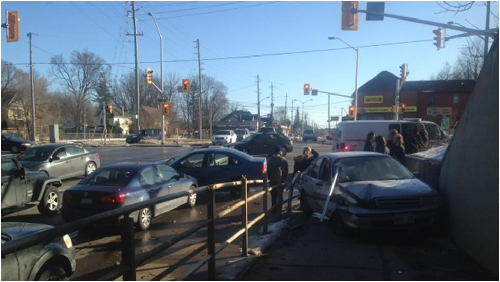 News media photo from February 16, 2016 of a car that was harpooned by a horizontal railing at the intersection of Horton Street and Wharncliffe Road in London, Ontario