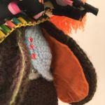 The Mad Hatter Amigurumi Doll. cardigan