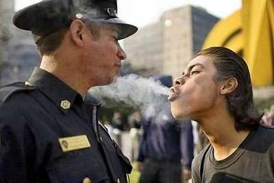 demonstration picture cop smoke in face