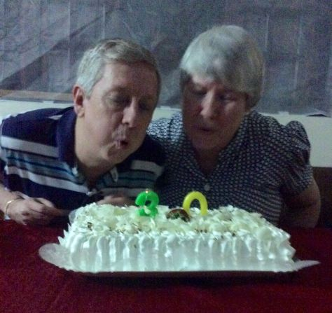 Blowing out the candles on our 30-year cake made by D. Claudete