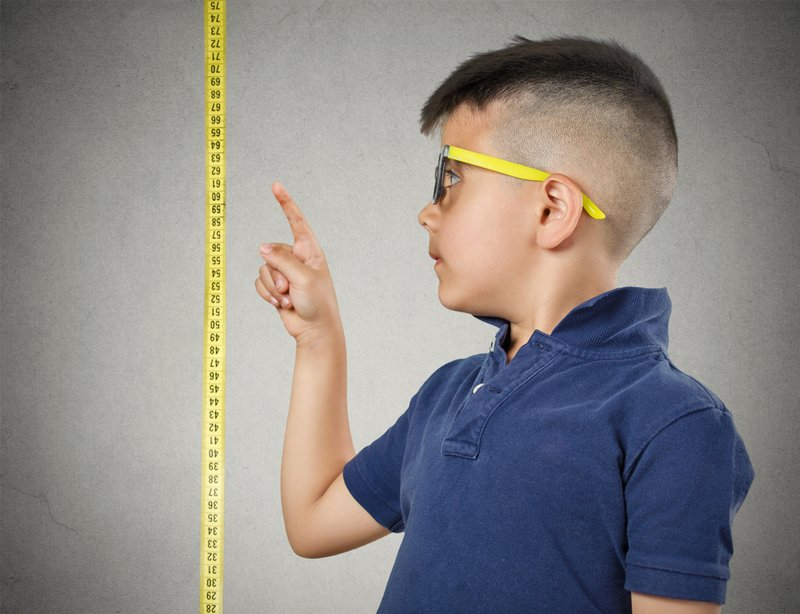 child and measuring tape