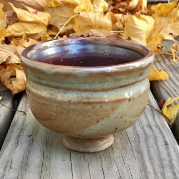 Waisted and footed tea bowl (shino over etc shino)