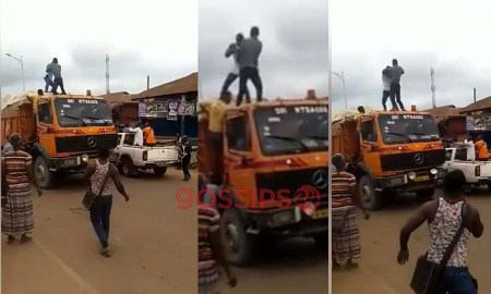 Two men, Men fight on a truck,