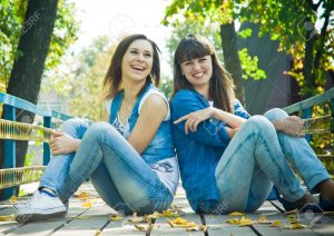 13785999-Girls-laughing-happilly-Stock-Photo-friends-jeans