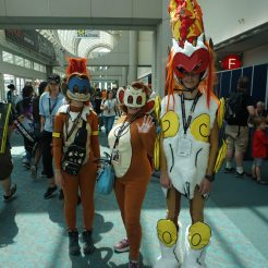 This awesome family cosplayed as a Chimchar, Monferno and Infernape from the Pokémon series.