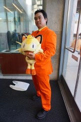 Giovanni and his Meowth from the Pokemon series.