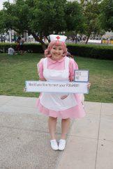 Chie returns to San Diego Comic Con with her nice Nurse Joy cosplay from Pokémon. Follow her on instagram (@dragoncherrychie)!