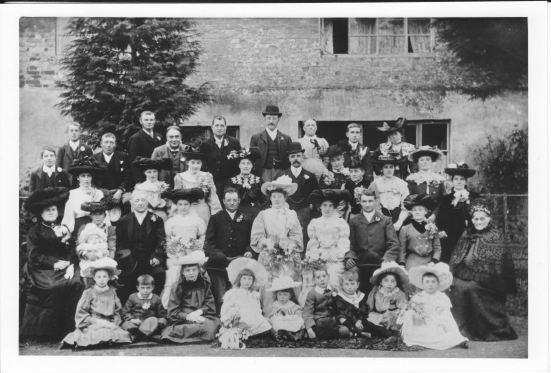 A wedding party outside The Mill, Oxenton, early 20th century.
