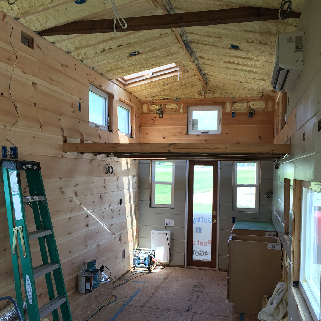 Installing kitchencabinets andgasstove in the TaHOW tinyhouseonwheels while hosting ahellip