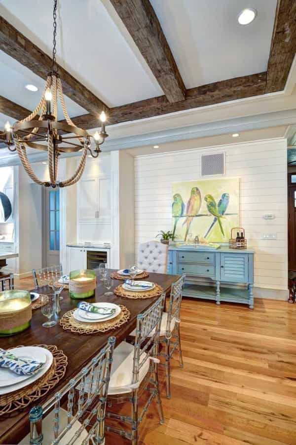 Coastal Style Dining Room With Exposed Beams And Nautical