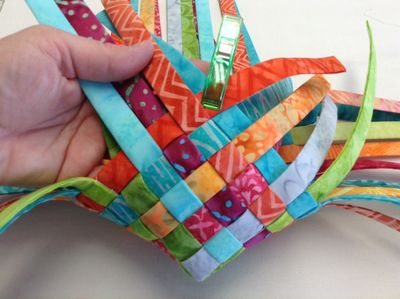 Are your fabric scraps out of control? Here's a scrap buster project to help you get them under control. Follow this tutorial to create a woven fabric basket by Atkinson Designs. - Sewtorial