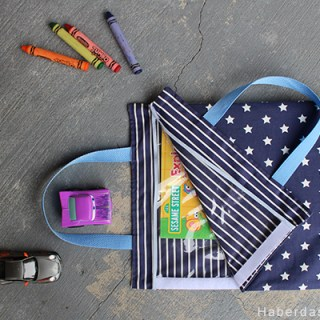 This VELCRO® Activity Bag by Haberdashery Fun is a dream. It features VELCRO® for easy opening and it's lined with clear vinyl for easy cleanup. -Sewtorial