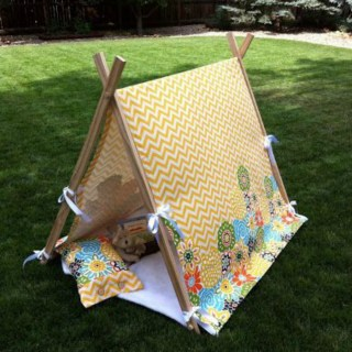 This child tent tutorial by Just Another Thing is simple to create if you know your way around a drill (or someone who does) and don't mind a little elbow grease. :)