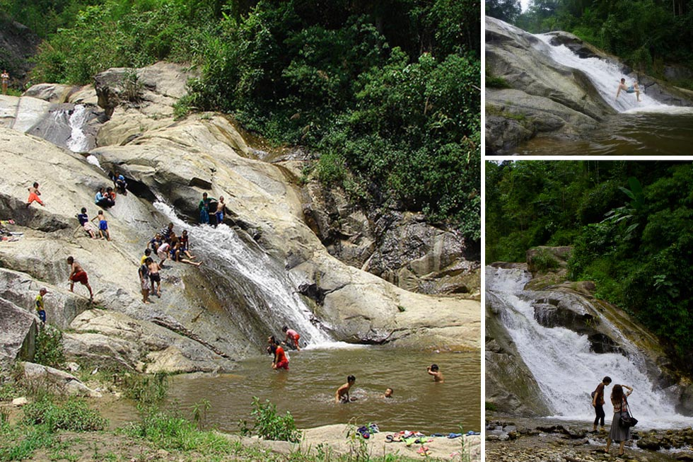 Sliding down from Mo Paeng Waterfall in Pai