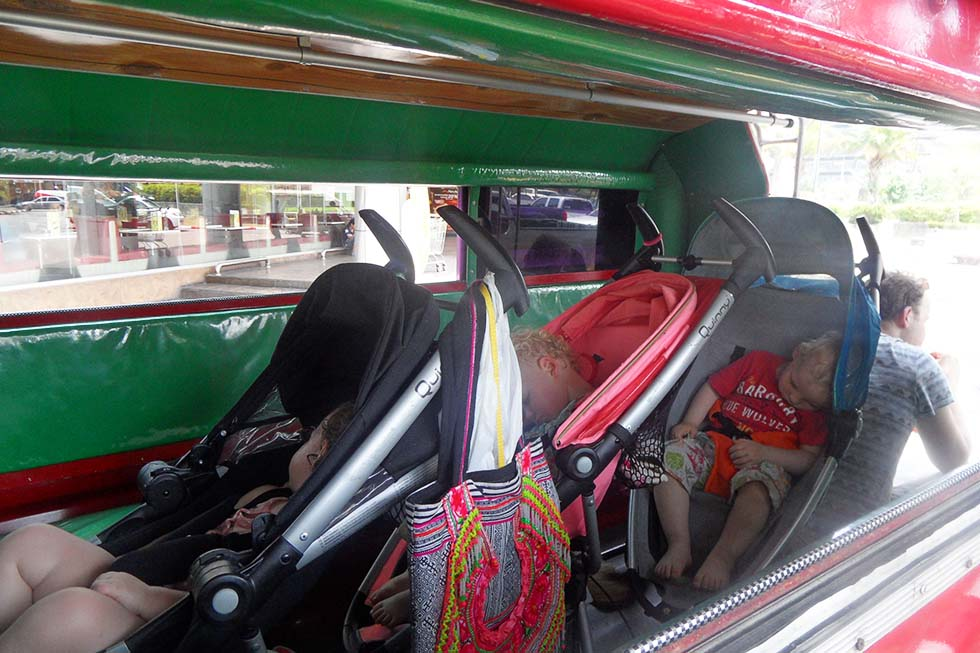 Taking the red taxi, songthaew, in Chiang Mai - Thailand with kids