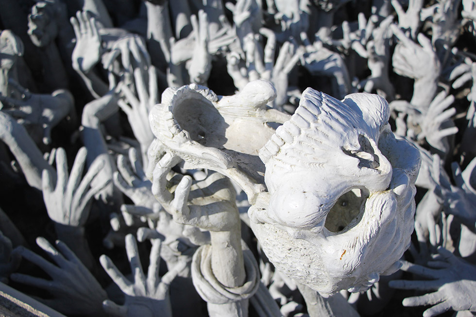 Hands and skulls at Wat Rong Khun
