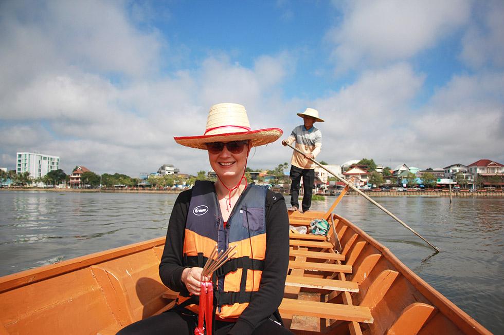 Mariska in the boat to Wat Tilokaram in Phayao