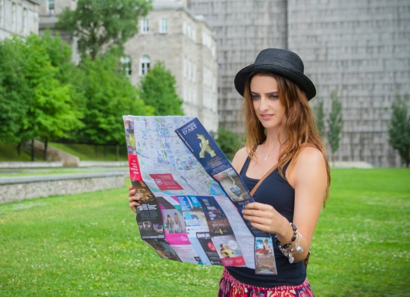 Travel girl reading map