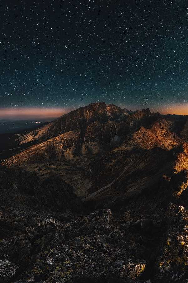 Night photography with mountains and clear sky