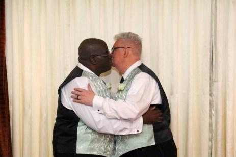 Sam Glass and Woody Goulart wedding kiss.