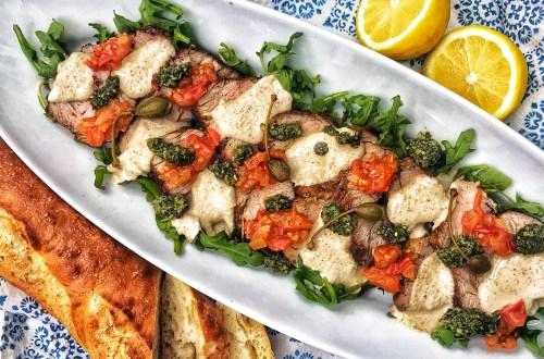 Vitello Tonnato, veal tenderloin with tuna sauce, basil pesto and tomato concassé