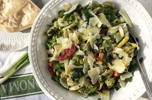 Warm gnocchi salad with greens, tomatoes and Parmesan