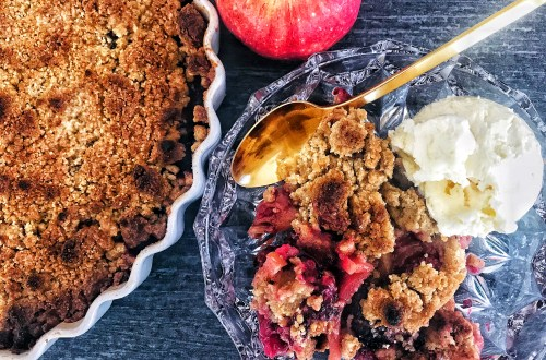 Apple blackberry crumble served with vanilla ice cream