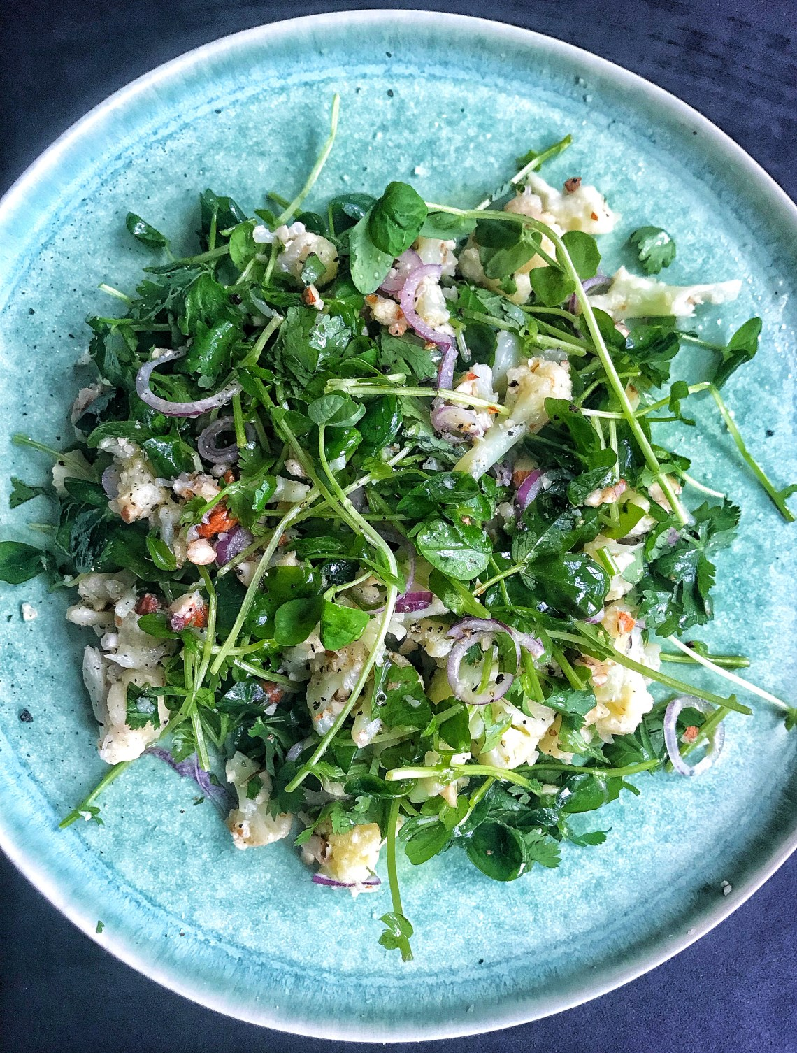 Cauliflower feel good salad - roasted cauliflower, microgreens, almonds, red onion and cilantro