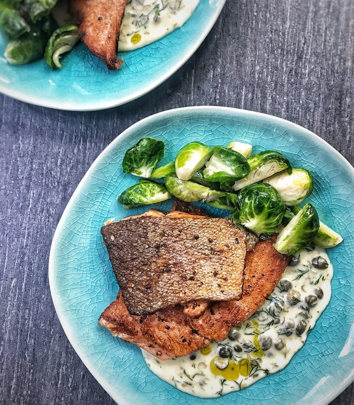 Pan-seared trout with creamy caper dill sauce and butter-roasted Brussels sprouts
