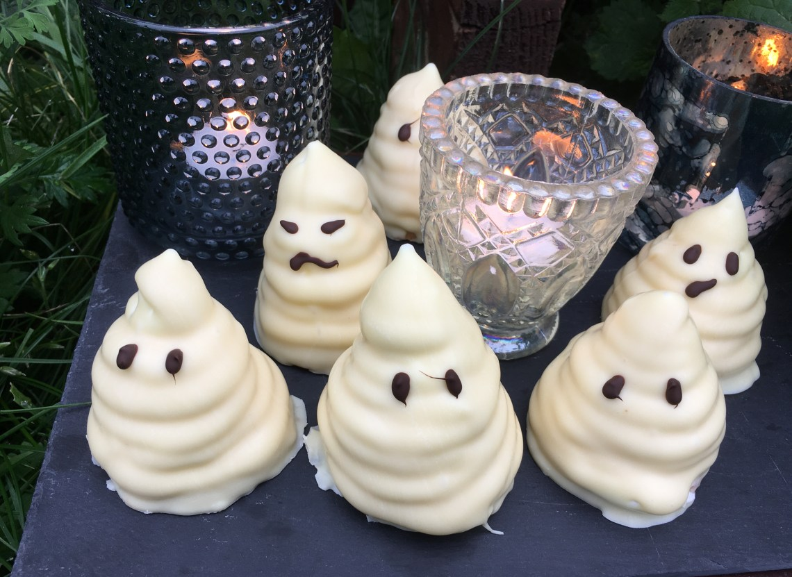Spooky Halloween treats. Sweet treats with lemon marshmallow filling covered in white chocolate