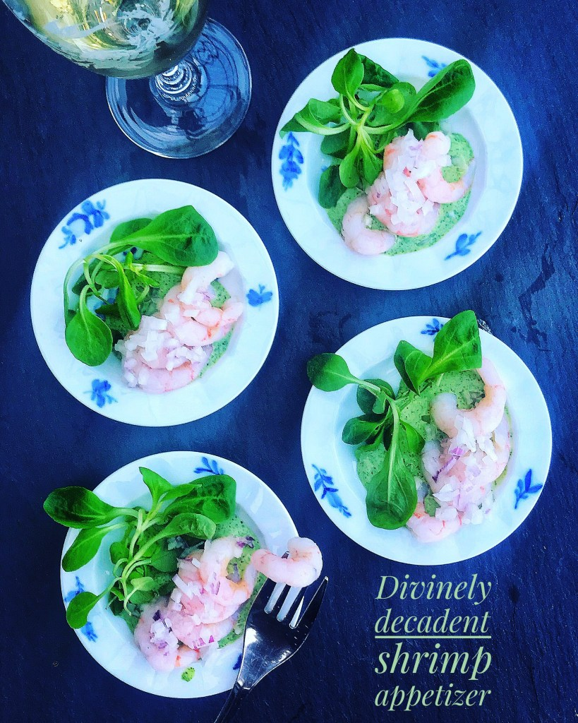 Shrimp appetizer with herb cream and watercress