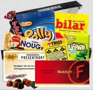Box med godis, biobiljetter, trisslott, presentkort och biobiljett