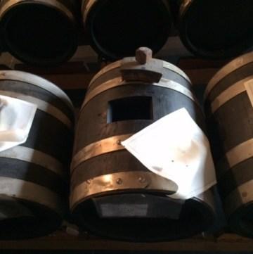 balsamic vinegar of modena in battery of barrels