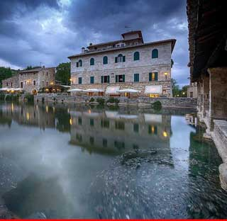 Bagno Vignoni as clouds darken