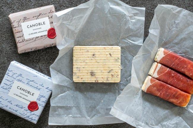カノーブルが「生ハム巻きバター」「ブルーチーズ入りバター」など、大人の夜を楽しむグルメなバター「カノーブル・グルマン」を5月30日に東京工場で発売。