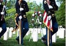 A wreath is placed at the grave of Army Private William Christman, the first person laid to rest at Arlington National Cemetery. Image source: www.dcmilitary.com