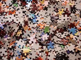 muddled box of jigsaw pieces