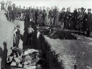 Mass_grave_for_the_dead_Lakota_after_the_massacre_at_Wounded_Knee_Creek